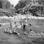 "A picture of the ""bathing beach"" on the Eau Claire River, below Boyd Park, 1912-1932."