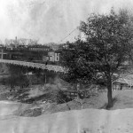 A picture of the original suspension bridge spanning the Eau Claire River, coming into what is now Boyd Park, from 1933.