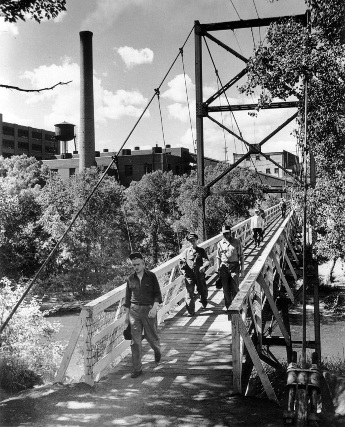 Crossing the footbridge